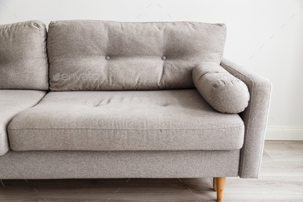 Grey Sofa With Wooden Legs In