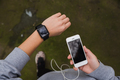 Young woman using wearable tech during fitness workout - PhotoDune Item for Sale