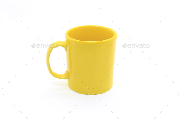 Bright yellow ceramic cup on white background - Stock Photo - Images