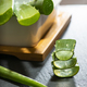 Aloe vera slices on dark background. Health and beauty concept. - PhotoDune Item for Sale
