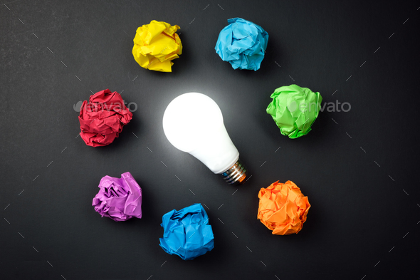 Great idea concept with crumpled colorful paper and light bulb - Stock Photo - Images