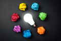 Great idea concept with crumpled colorful paper and light bulb - PhotoDune Item for Sale