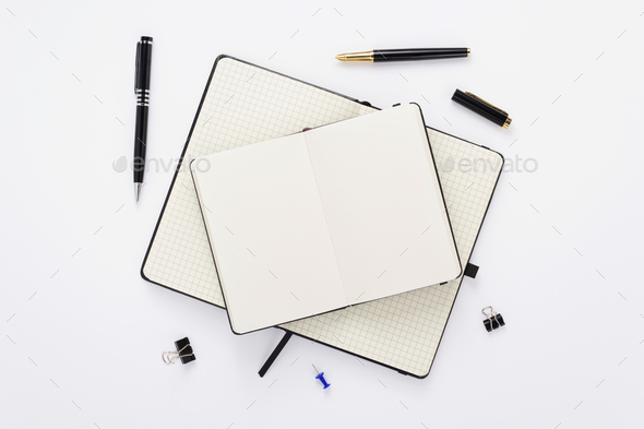notebook and stationary at white - Stock Photo - Images
