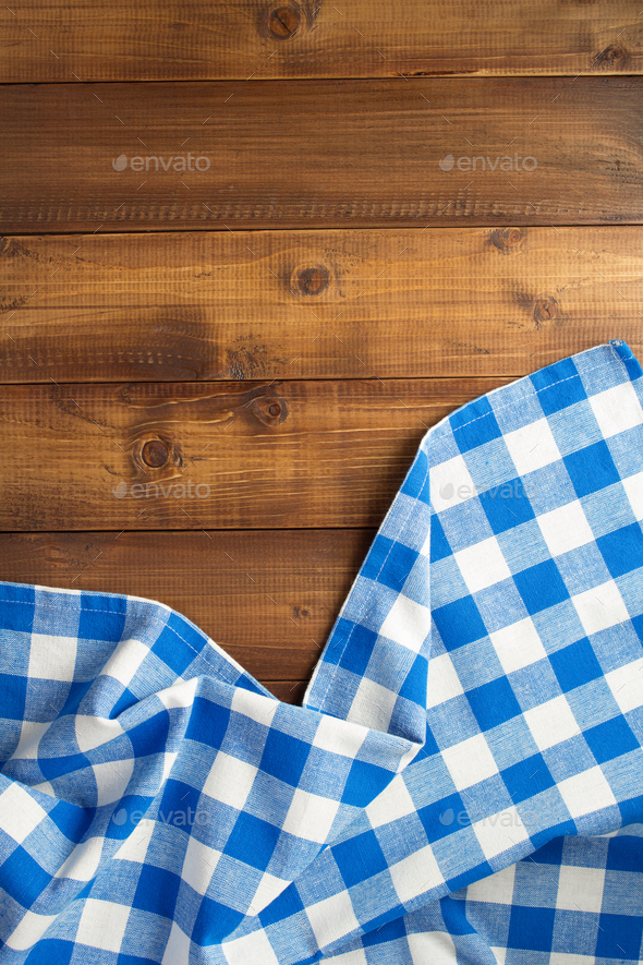 checked cloth napkin at wooden table - Stock Photo - Images