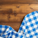 checked cloth napkin at wooden table - PhotoDune Item for Sale