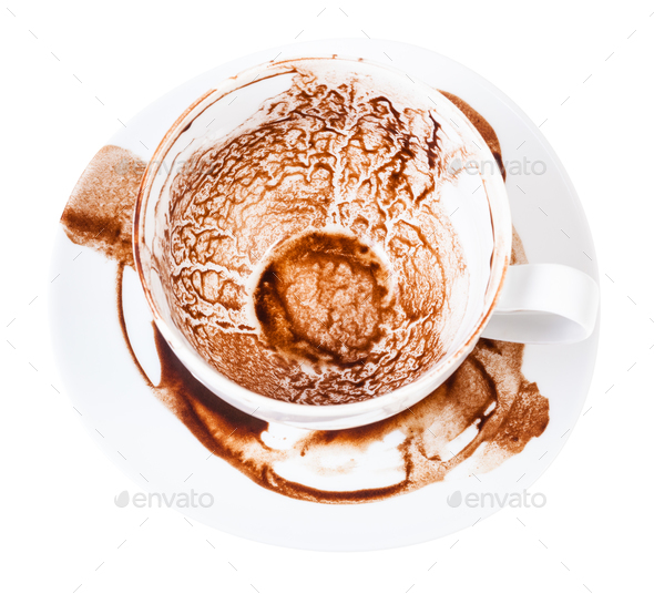 cup on saucer with pattern of carob sediments - Stock Photo - Images