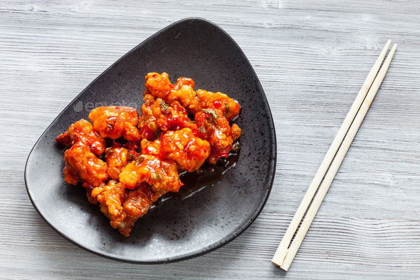 spicy fried Chicken with chopsticks close up - Stock Photo - Images