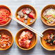 chopsticks above various appetizers in bowls - PhotoDune Item for Sale