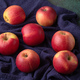Red apples on blue - PhotoDune Item for Sale