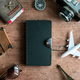 Retro camera with toy plane, passport, travel items and dairy, Travel concept - PhotoDune Item for Sale