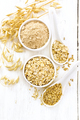 Oat flakes with flour and grain on board top - PhotoDune Item for Sale