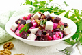 Salad with beetroot and apple in plate on board - PhotoDune Item for Sale