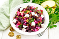 Salad with beetroot and walnuts in plate on board - PhotoDune Item for Sale