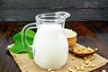 Milk soy in jug with flour on dark board - PhotoDune Item for Sale