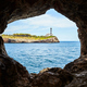 Portocolom Lighthouse seen from a cave, Mallorca. - PhotoDune Item for Sale
