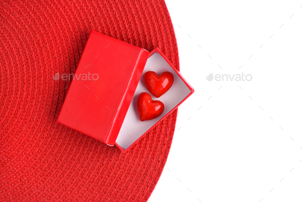 Valentines Day background. Two hearts in a red gift box with spa - Stock Photo - Images