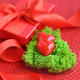 Valentines Day background. Hearts in green moss with red gift bo - PhotoDune Item for Sale