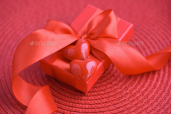 Valentines Day background. Hearts with red gift box on red backg - Stock Photo - Images