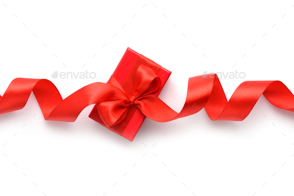 Red gift box with red ribbon on white background. Top view - Stock Photo - Images