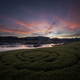 Golden sunset over a river with a spiral in the grass - PhotoDune Item for Sale