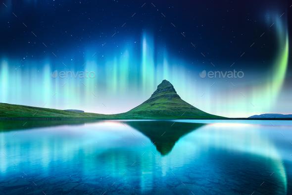 Green aurora light behind kirkjufell mountain - Stock Photo - Images