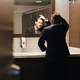 Worried Hispanic Business Man Looking At Hairline In Office Restrooms - PhotoDune Item for Sale