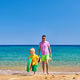Toddler boy walking on beach with father - PhotoDune Item for Sale