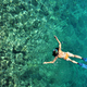 Woman snorkeling at Phi Phi Island, Phuket, Thailand - PhotoDune Item for Sale