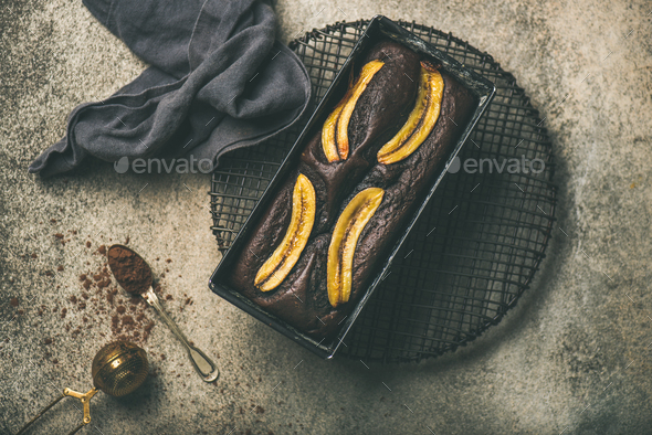 Chocolate banana bread cake with cinnamon in baking tin - Stock Photo - Images