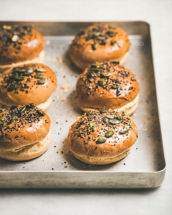 Freshly baked homemade buns with seeds for cooking burgers - Stock Photo - Images