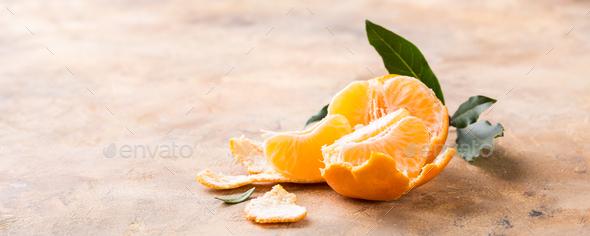 Fresh peeled mandarin tangerine - Stock Photo - Images