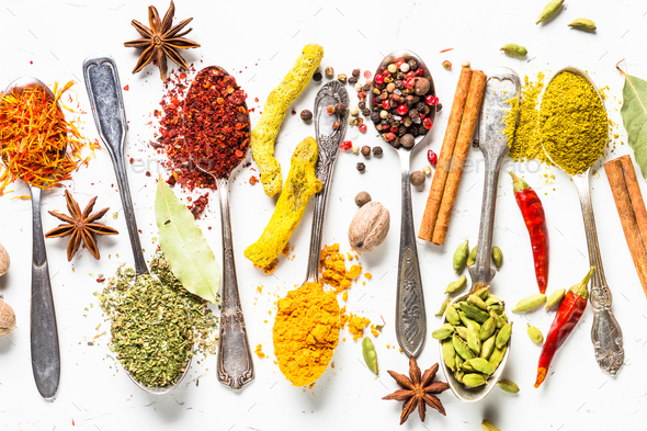 Set of various spices in spoons on white - Stock Photo - Images