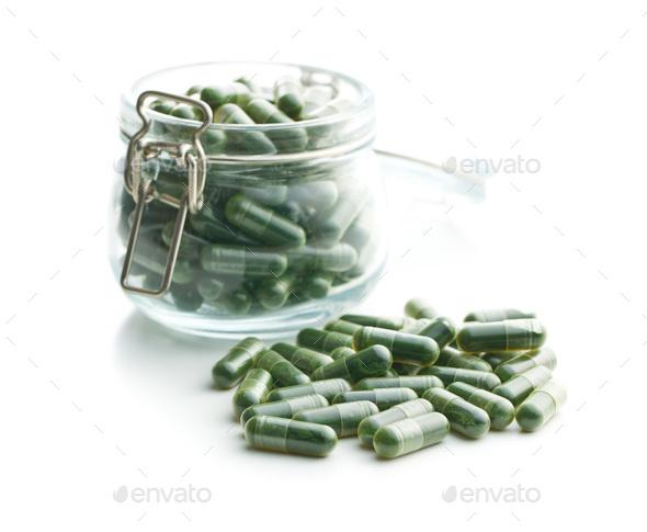 Green chlorella pills or green barley pills. - Stock Photo - Images