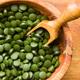 Green chlorella pills or green barley pills in bowl. - PhotoDune Item for Sale