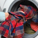 Woman puts clothes in washing machine - PhotoDune Item for Sale