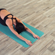 Full length of a young woman sitting in child pose on a yoga mat - PhotoDune Item for Sale