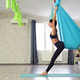 Adult woman practices anti-gravity yoga position in studio - PhotoDune Item for Sale