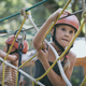 little brother and sister make climbing in the adventure park. - PhotoDune Item for Sale
