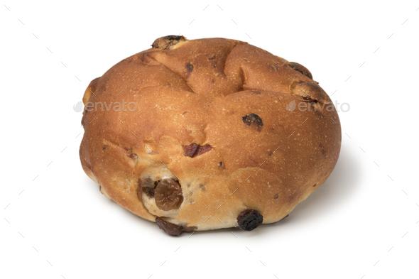 Single fresh baked raisin bun - Stock Photo - Images