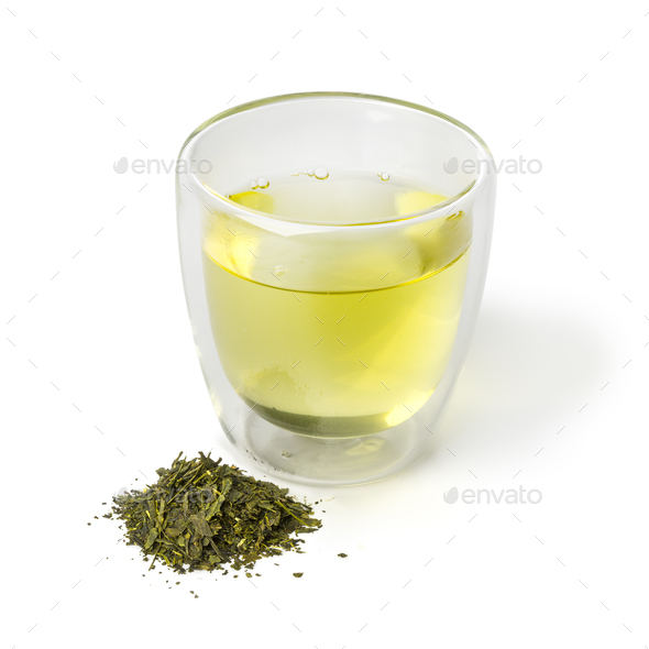 Cup of Japanese green tea and a heap of dried green tea leaves - Stock Photo - Images