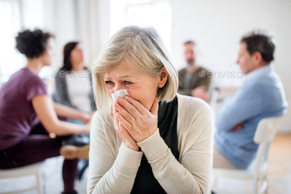 A portrait of senior depressed woman crying during group therapy. - Stock Photo - Images