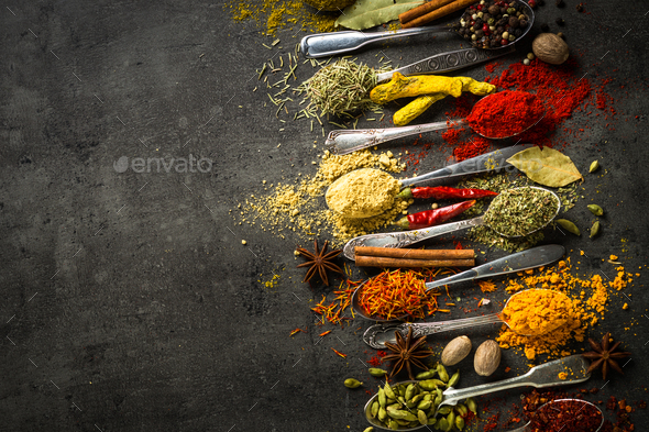 Set of various spices in spoons on black background. - Stock Photo - Images