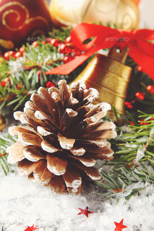 Pinecone with christmas decoration and snow - Stock Photo - Images