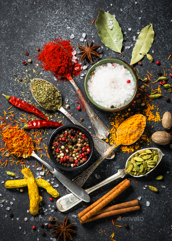 Set of various spices  on black stone background. - Stock Photo - Images