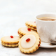 Empire shortbread sandwich cookies and cup of coffee - PhotoDune Item for Sale