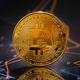 Gold bitcoin standing on financial graphs for cryptocurrency prices - PhotoDune Item for Sale