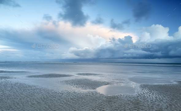 stormy clouds over North sea coast - Stock Photo - Images