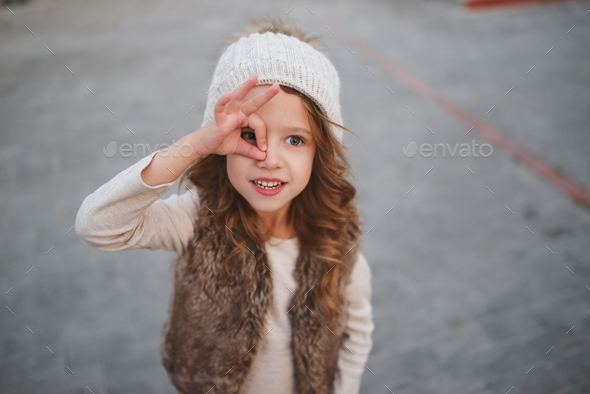 cute little girl with knitted hat - Stock Photo - Images