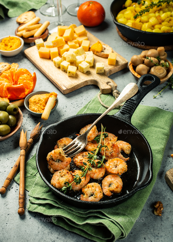 Shrimps roasted on frying cast iron pan - Stock Photo - Images