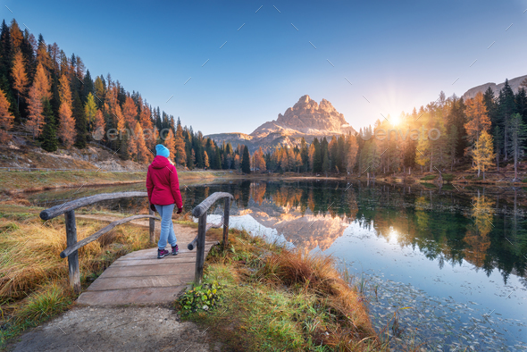 Young wooman on the small wooden bridge against lake - Stock Photo - Images